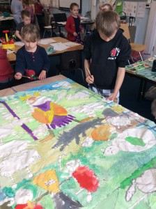 painting The Good Shepherd banner - Launton C of E Primary