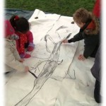 finishing touches to a collaborative tree drawing